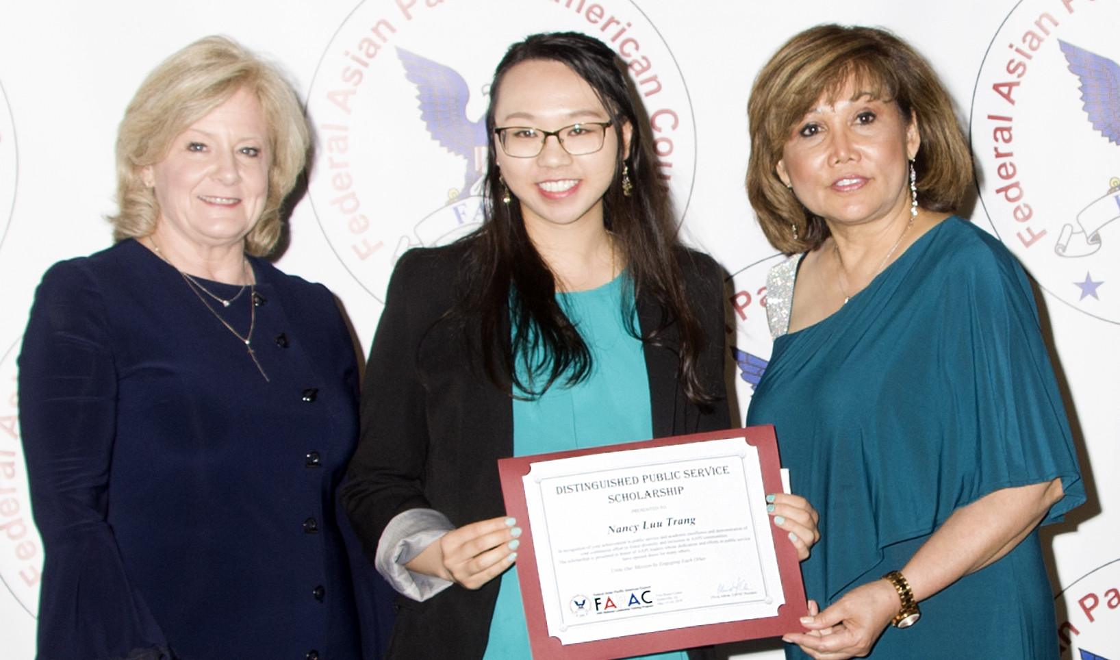 Nancy Trang (Center) with Marshall Space Flight Center Director Jody Singer (left) and FAPAC President Olivia Adrian (right)